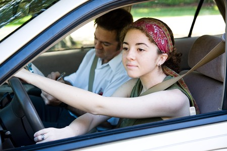 test drive: Teen driver taking driving lessons from professional instructor.