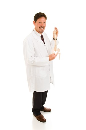 Chiropractor holding model of a human spine.  Full body isolated on white. photo