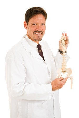 spinal manipulation: Handsome chiropractor holding up a scale model of the human spine.  Isolated on white. Stock Photo