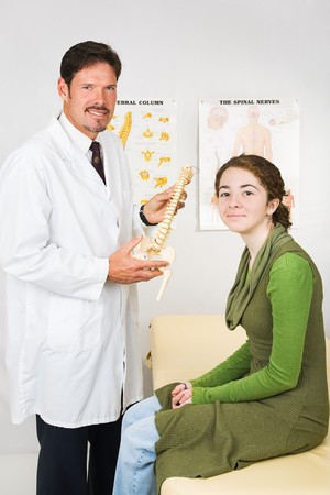 spinal manipulation: Happy smiling chiropractor and patient during an office visit.   Stock Photo