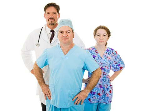 competent: Competent trustworthy medical team - doctor, surgeon and nurse.  Isolated on white. Stock Photo