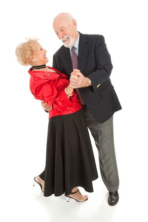 Romantic senior couple dancing together.  He's dipping his beautiful wife.  Full body isolated.