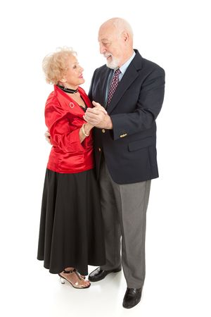 Beautiful senior couple dressed up and dancing together.  Full body isolated on white.   photo