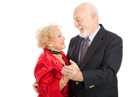 Loving seniors couple out dancing together.  Isolated on white background photo