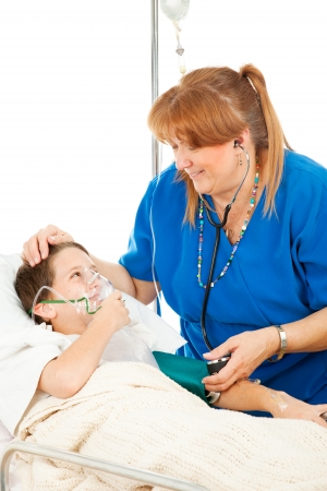 Friendly pediatric nurse comforts a small boy in the hospital.   photo
