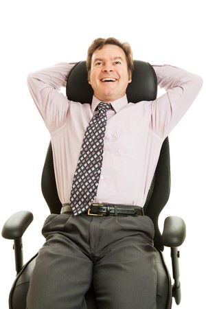Businessman leaning back and enjoying his new ergonomic chair.  Isolated on white. photo