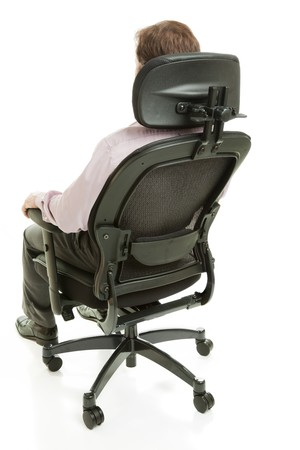 adjustable: Executive sitting in a fully adjustable ergonomic office chair.  Full body isolated on white. Stock Photo