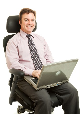 armrest: Handsome businessman sitting and working in an ergonomic chair.  Isolated on white. Stock Photo