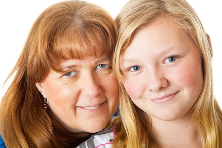 Closeup portrait of a beautiful blond, blue-eyed mother and daughter. Stock Photo - 4443057