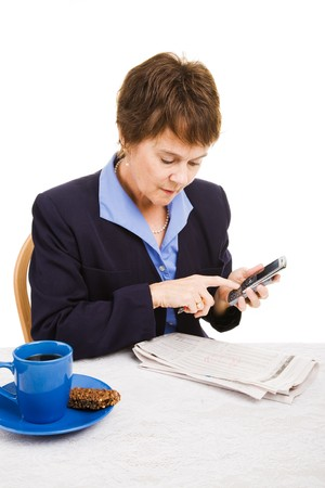 classifieds: Unemployed businesswoman reads classifieds and makes calls.  Isolated on white. Stock Photo
