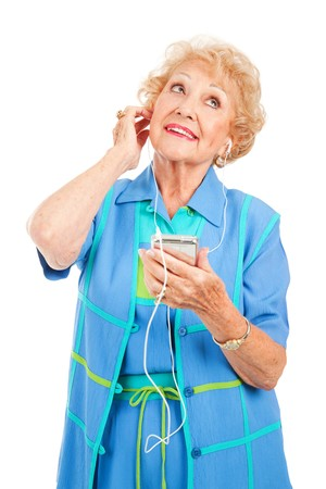 portable mp3 player: Beautiful senior lady playing music on her portable mp3 player.  Isolated on white.