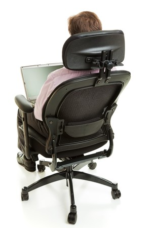swivel: Rear view of a business man sitting in an ergonomic chair and using his computer.  Full body isolated on white. Stock Photo