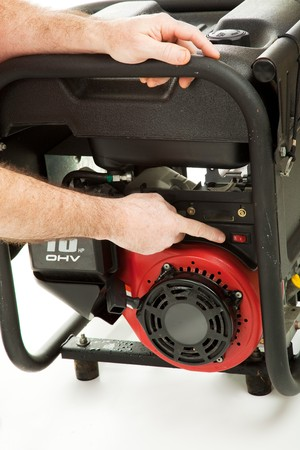 way out: Mans hands pointing out the way to safely operate a portable emergency generator.