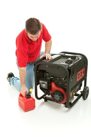 gasoline powered: Man preparing to fill his gasoline powered generator with fuel.  Isolated on white.   Stock Photo