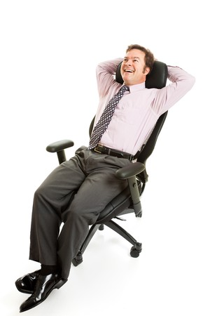 comfortable chair: Businessman leans back and relaxes in his comfortable ergonomic chair.  Isolated on white. Stock Photo