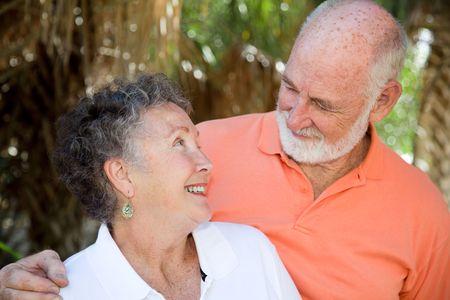 Adorable senior couple gazes lovingly into each others eyes. Stock Photo - 4531410