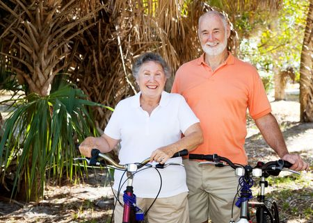 Happy active senior couple enjoys bicycling together. Stock Photo - 4531419