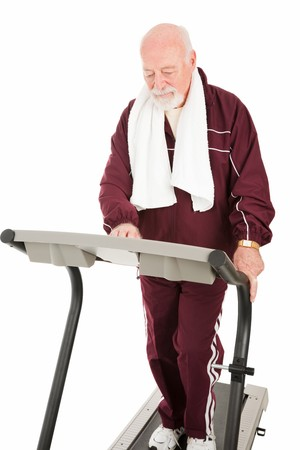Fit senior man working out on treadmill.  Isolated on white. Stock Photo - 4566194
