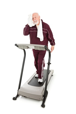 get in shape: Senior man exhausted from trying to get back in shape.  Isolated on white.