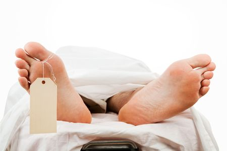 malpractice: Closeup of a corpse on a gurney wearing a toe tag. Isolated with path.