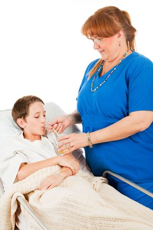 bedside: Nurse gets a young patient to drink a glass of orange juice.  Isolated on white.