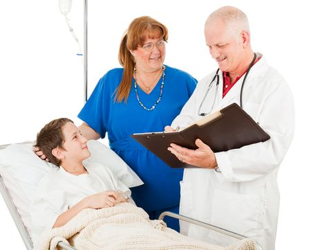 bedside: Pediatrician and nurse ireviewing the chart of a little boy in the hospital.  Isolated on white.