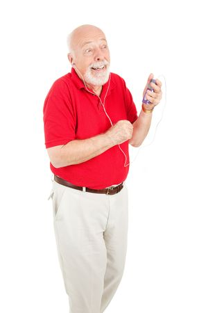 Senior man enjoys listening to music on his MP3 player.  Isolated on white.