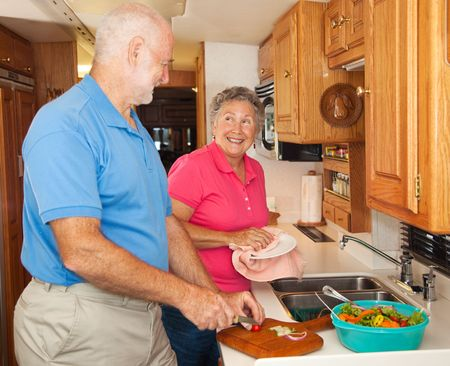 Retired senior couple in the kitchen of their RV camper.   photo