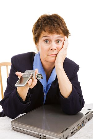Mature business woman upset because business is dead - no phone calls or internet traffic.   photo