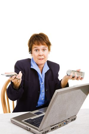 unskilled: Middle-aged woman going back to work, confused by latest business technologies. Isolated on white.