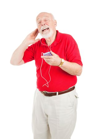 Senior man listening to his favorite tunes on a new mp3 player.  Isolated on white. photo