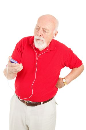 Senior man frustrated with mp3 player photo