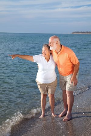 Retired senior couple on vacations taking in the sights at the beach.   photo