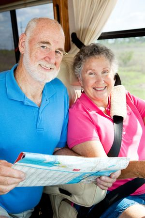 Portrait of a senior couple traveling together in their motor home.   photo
