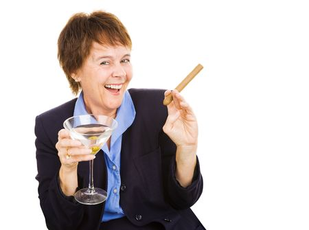cigar smoking woman: Mature businesswoman partying with a martini and a cigar.