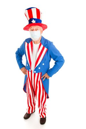 Uncle Sam wearing a surgical mask to protect against congatious illness.  Full body isolated. photo