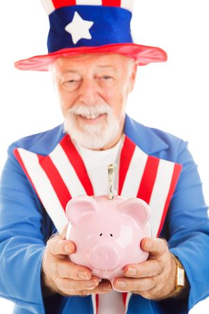 Closeup of Uncle Sams hands as he holds a piggy bank with a 20 dollar bill in it.  Focus on the pig. photo