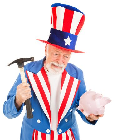 Uncle Sam prepares to break into his piggy bank.  Metaphor for US recession.  Isolated photo