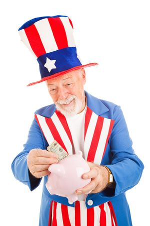 Realistic Uncle Sam saving money in his piggy bank.  Metaphor for American economy.  Isolated photo