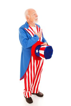 recite: Uncle Sam standing at attention to recite the pledge of allegiance.  Full body isolated. Stock Photo