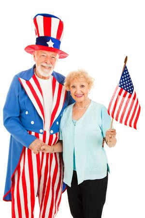 Pretty senior woman meets American icon Uncle Sam.  Isolated. photo