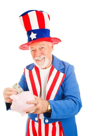 sam: American icon Uncle Sam saving money in his piggy bank.  Isolated. Stock Photo