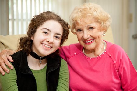 seventy two: Portrait of beautiful grandmother and teen granddaughter.