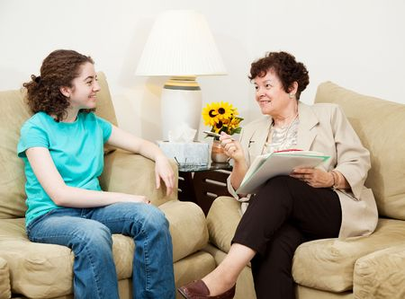 Teen girl being interviewed by a mature woman.  Could be college or job interview, or counseling session. Stock Photo - 5078023