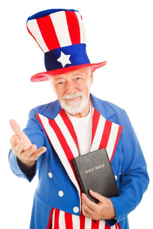 stereotype: American icon Uncle Sam holding a bible and making a welcoming gesture.  Isolated on white Stock Photo