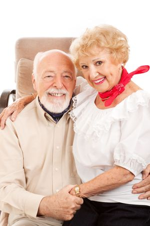 Adorable country western senior couple cuddling up together. photo