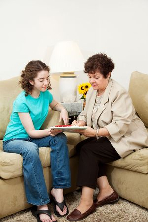 filling out: Teen girl and older woman filling out paperwork during an interview. Could be counseling session or job application.  Vertical with copyspace. Stock Photo