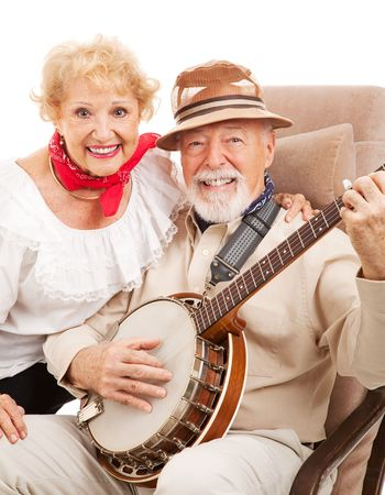 Portrait of senior couple who play banjo and sing country music.   photo