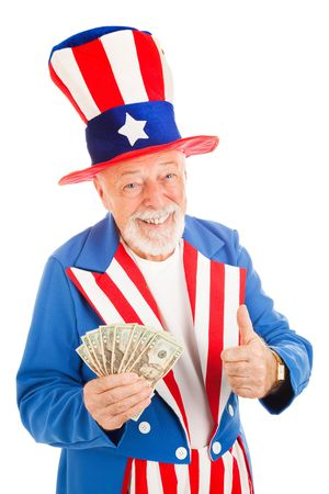 uncle sam hat: American icon Uncle Sam holding a fist full of money and giving a thumbs up sign.  Isolated. Stock Photo