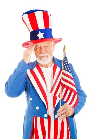 uncle: American icon Uncle Sam salutes the US flag.  Isolated on white.